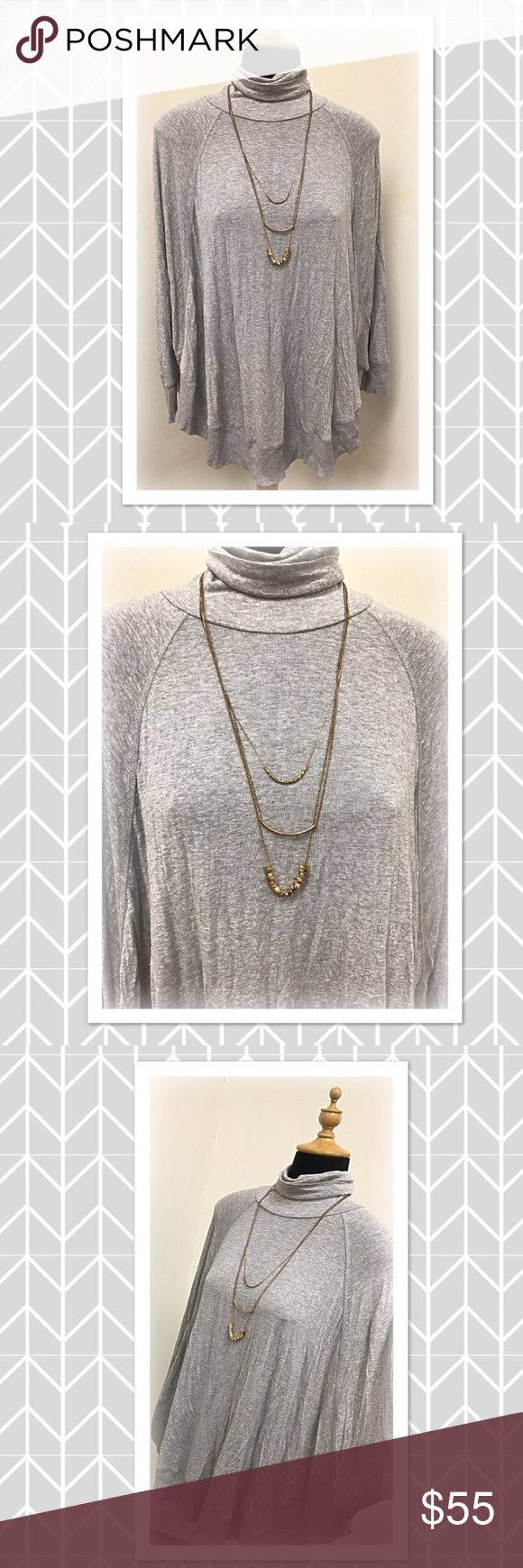 Gray long sleeve turtleneck top Beautiful gray long sleeve turtleneck top. This is a gorgeous top and lightweight. It is extremely well made and very comfortable. Material content is 98% viscose and 2% spandex. Chelsea & Theodore Tops Blouses