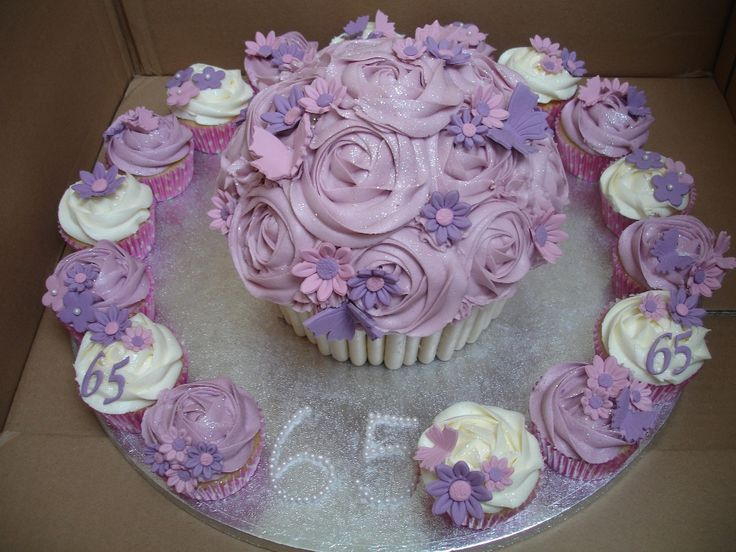 Google Image Result for http://crazydaisiesbakery.co.uk/wp-content/uploads/2011/09/65th-giant-cupcake.jpg
