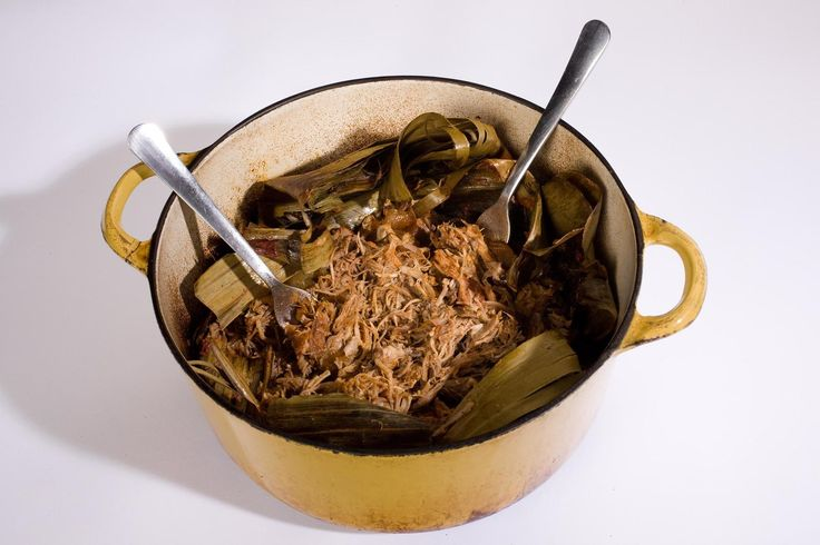 In this oven version of Yucatán-style pit pork, the meat marinates in an orange and achiote mixture before being wrapped in banana leaves and slow-cooked.