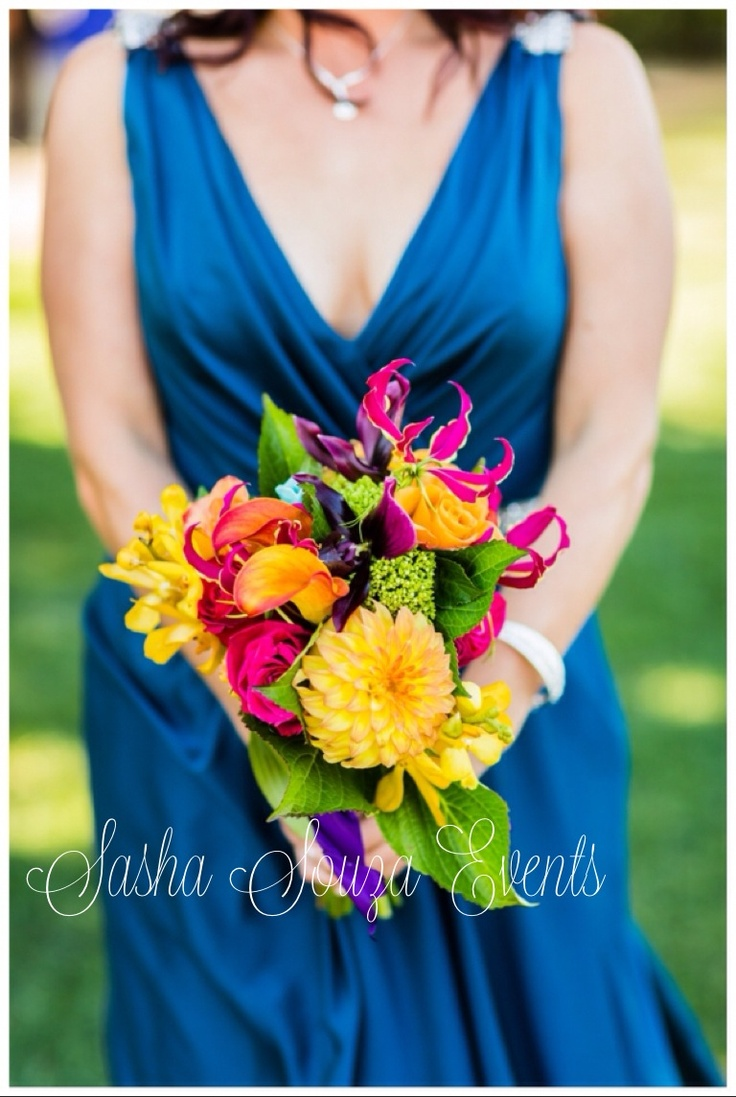Daily Pretty: Bright and colorful bridesmaid bouquet with yellow dahlia, dark purple calla lily, young hydrangea, hydrangea leaf, orange vanda orchids, Ecuadorian roses and fuschia gloriosa lilies. Image by Damion Hamilton.
