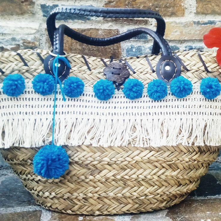 Straw bag with  pom-  pom