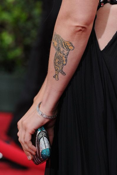 Alanis Morissette Tattoo – 50 Celebrity Tattoos – Photos – Buchanan