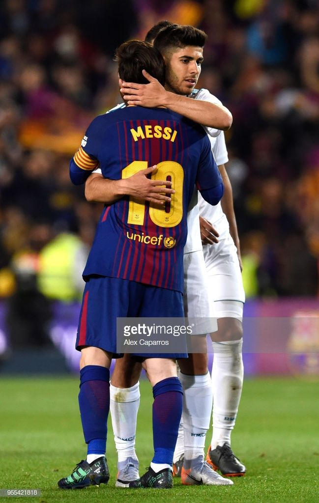 Lionel Messi of Barcelona and Marco Asensio of Real Madrid embrace ... 25f32dafce25d
