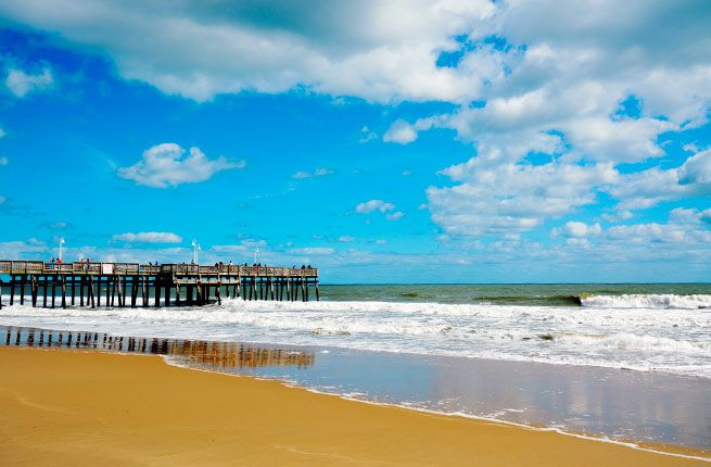 Sandbridge Beach         Where: Virginia     Most beachgoers have heard of Virginia Beach, but few are familiar with its tiny neighbor to the south. Located 15 miles from the resort area, Sandbridge features pristine dunes and secluded beaches away from the Virginia Beach crowds.