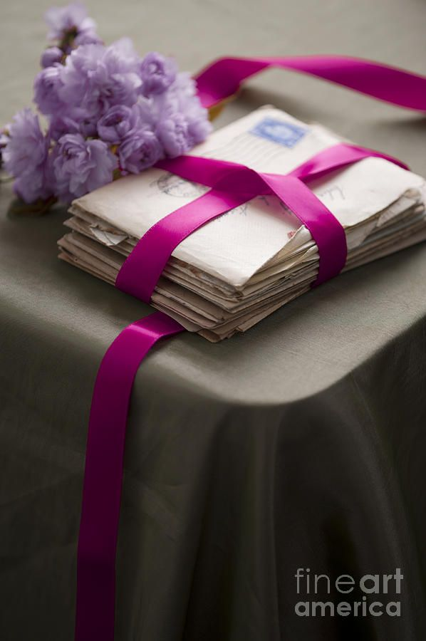 Perfect as a gift from the maid of honor, have close friends and family write letters to the bride. Wrap these letters in ribbon, or place them in a photo album. This heartfelt gift is sure to leave the bride shedding a few tears so consider including a box of tissues!