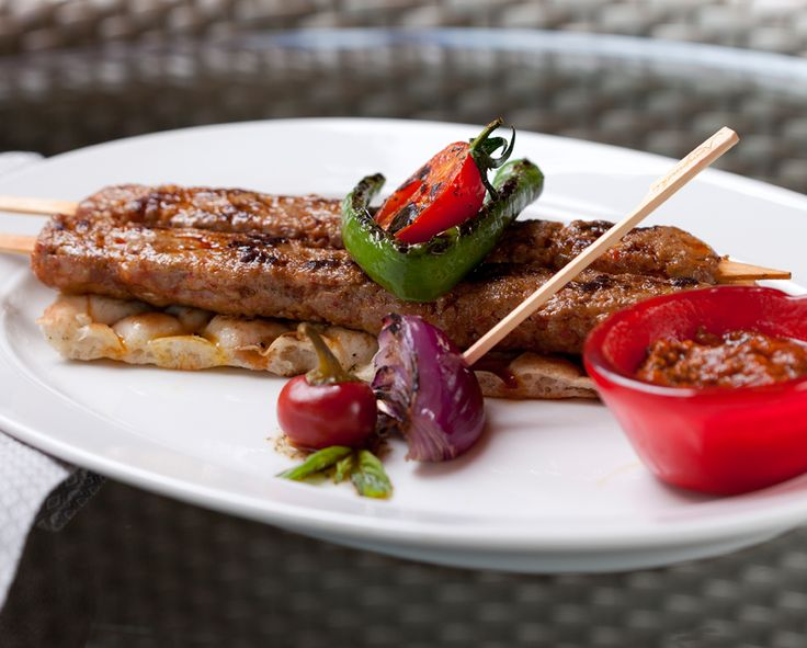 Mini Adana kebab skewer with pepper and mint relish