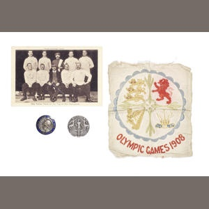 Tug of War - Silver Medal  A silver medal awarded to Constable James M. Clark, Liverpool Constabulary, boxed, and inscribed on the lid; together with a boxed bronze and enamel Competitor's medal, a photograph of the Silver Medal winning team plus an embroidered Olympic Team jersey badge. Also a collection of personal memorabilia from the life of James M. Clark (1874-1926) including Birth, Marriage and Death certificates, Scots Guards Army service documents and memorabilia, Probate and…