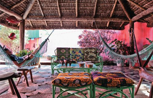 A covered outdoor room with double hammocks....the perfect tete-a-tete