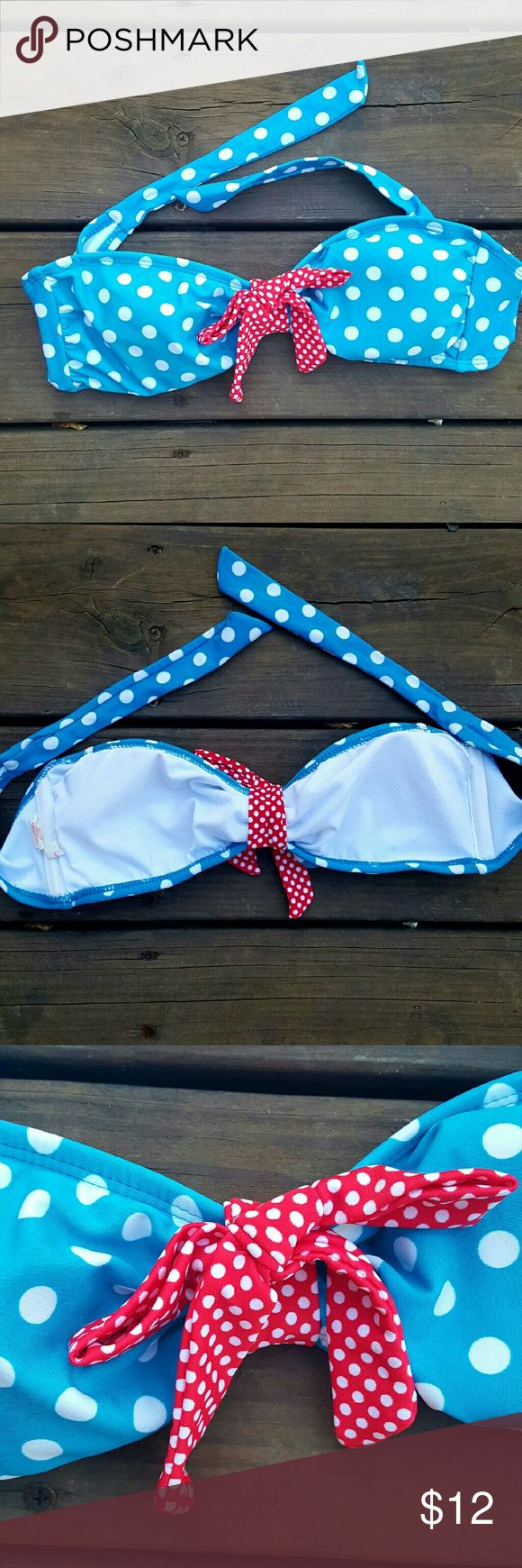 Polka Dot Xhilaration Bandeau Bikini Top PERFECT for the 4th of July!! Worn only a few times with no signs of wear. The back of it ties, and I unfortunately do not have the straps to go along with it. The bow in the middle does not make the top come apart when untied.   Size medium  *reasonable offers accepted Xhilaration Swim Bikinis