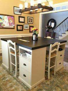 Great concept for a craft table - notice: it's a taller table with stools! Great lighting too!  Could break down and store against the wall