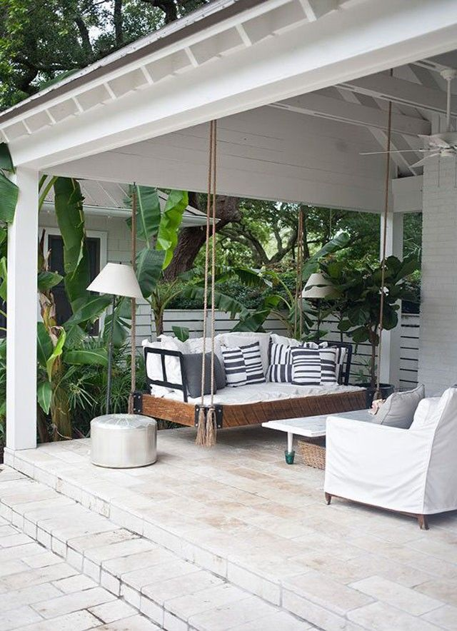 Foliage and a big beautiful porch swing that might as well be a daybed. #porchswings #outdoorliving