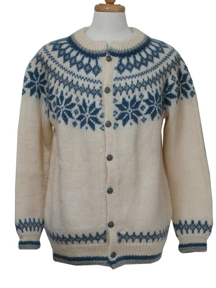 Vintage Dale of Norway 1980s Caridgan Sweater: Late 80s or early 90s -Dale of Norway- Mens pale ivory, marine blue and grey traditional patterned Norwegian wool cardigan sweater. Rib neck, cuffs and waistband with button front that closes with embossed silver tone buttons.