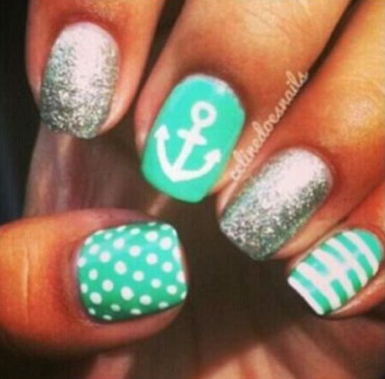 My favorites! Turquoise nails with an anchor, polka dots, stripes, and silver accents.