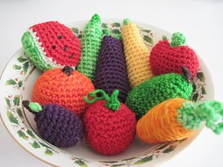 """This pattern is for crocheted fruit. It includes instructions to make an apple, plum, watermelon slice, orange, and strawberry. The fruits measure 3-4"""" each. These are all very simple to make and only take about a half an hour each!"""