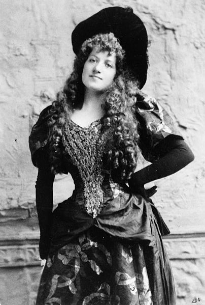 """Lottie Collins (16 August 1865–1 May 1910) was an English singer and dancer, most famous for introducing the song """"Ta-ra-ra Boom-de-ay!""""  (Photo ca. 1892)"""