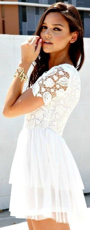 A white lace/crochet dress is a great piece. It can easily be defined by the shoes you pair it with while still holding its own.