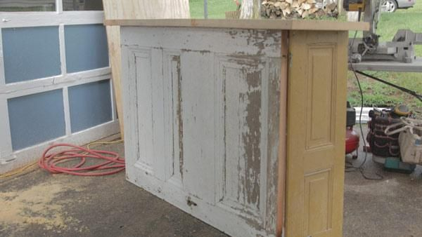 Old Shutter and Door Bar - Want a high-end bar without the expensive $3,000 price tag? Learn how to build your own for only $100! With old shutters and doors from a salvage shop, you don't need a ton of money to have great style.