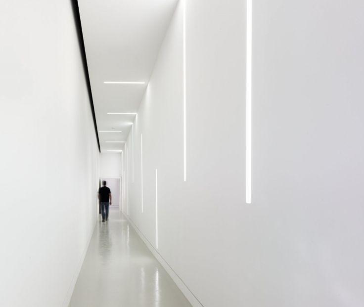   LIGHTING   love the light details. Clean white corridor inside the Botín Foundation by MVN Architects. #lighting #white #interiors