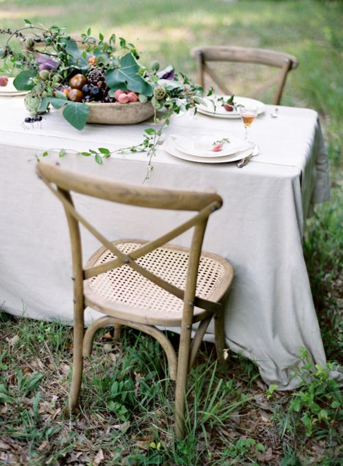 Simple white linens and a mixture of wooden furniture #designsponge #dssummerparty