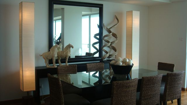 Well chosen accessories create interest - reflective surfaces like mirrors and glass provide a feel of space.