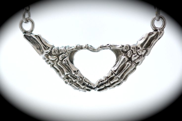 silver skeleton hands making an I heart you sign necklace Blue Bayer Design NYC quantity listing. $45.00, via Etsy.