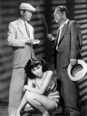 Stray Dog (野良犬/ Nora Inu, 1949)  by Kurosawa Akira.  A film noir set in a heatwave striken post-war Tokyo. Rookie detective's (Mifune) colt pistol is stolen during the scorching bus ride. There were seven rounds in the gun,  so he needs to catch up with the culprit fast, before all of them are used in the crimes. Inside look into the anatomy of crime, it feels very Dostoyevsky influenced. As usual with Kurosawa's classics, it's a photographer's dream of a movie.