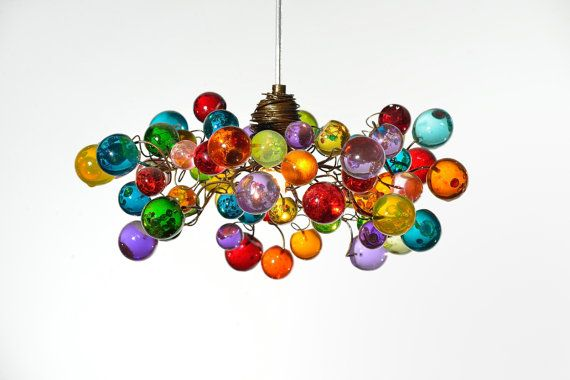 Multicolored bubbles pendant light for Kitchen island , A bouquet of bubbles at rainbow color . The light goes through these resin bubbles and creates a stunning and delicate shade on the wall. The Ceiling chandelier is elegant , unique and will be a piece of jewelry in your bedroom,