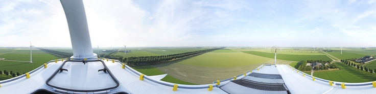 This picture is shot from a windmill in the Flevopolder in The Netherlands. At an altitude of more then 100m (330ft) high you'll have a unique overview over the Flevopolder and the farmland around you.
