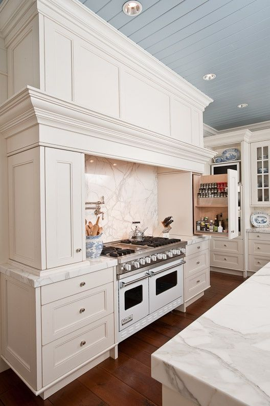 Fabulous range surround with marble backsplash, pot filler, drawers, and slide-out spice shelf.