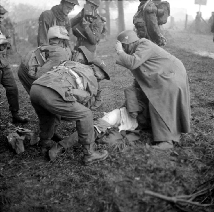 British medics of the British Commandos and a German POW tend to a casualty during the first day of landings on the island of Walcheren. On 1 November 1944 the British Special Services Brigade...
