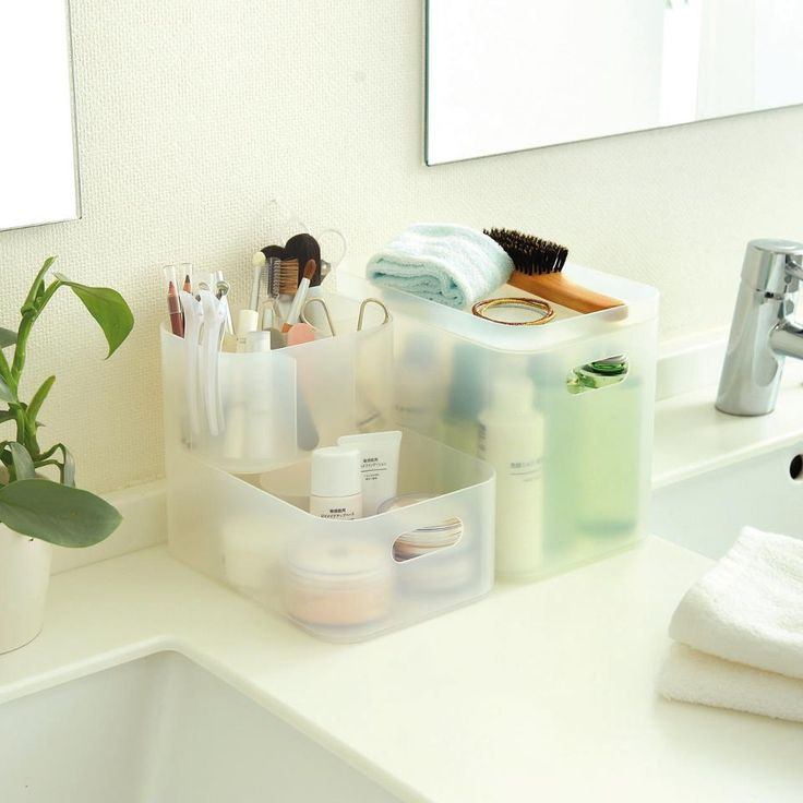 Muji storage boxes for the bathroom.                                                                                                                                                                                 More