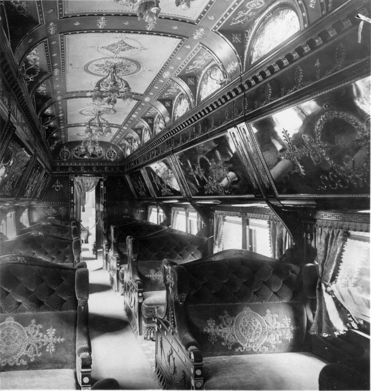 Train Travel in the 1800s - The interior of a Rococo period Pullman train car.