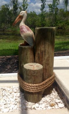 "Nautical wood pilings. Make this for less than $20. 7"" round treated fence post wrapped with rope."