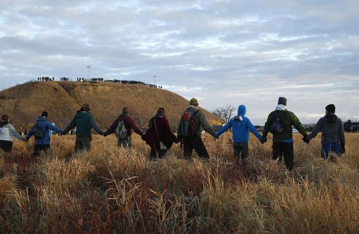 Thanks to President Obama, the US Army Corps of Engineers has blocked the Dakota Pipeline Access Route. ( In November, protesters joined hands as police lined the hill at Standing Rock during a dispute over the building of the Dakota Access pipeline. )