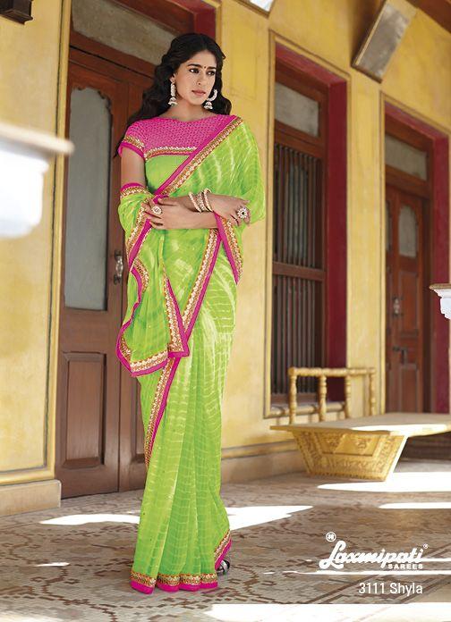 Stunning Leheriya prints on parrot green georgette saree looks cool with pink jari work border  studded diamond on whole saree.