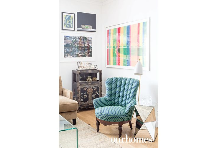 "Styled with sophistication, the living room blends new pieces with historic architecture. This 100-year-old chair was reupholstered then paired with a geometric mirrored side table. See more of this home in ""Century Home's Backyard Becomes an Urban Resort"" from OUR HOMES London Spring 2017: http://www.ourhomes.ca/articles/build/article/century-homes-backyard-becomes-an-urban-resort?full=true"