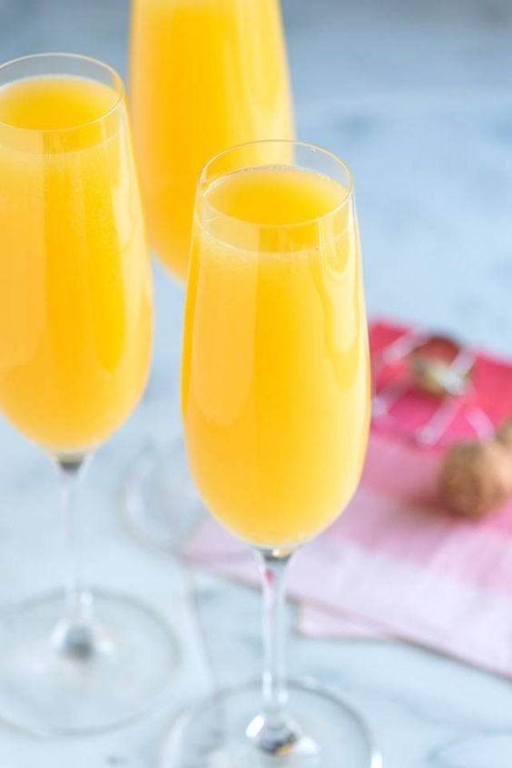 What's better to serve at brunch than a fabulous mimosa cocktail made with dry sparking wine and orange juice? From inspiredtaste.net | @inspiredtaste