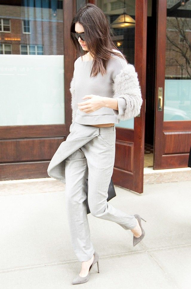 Kendall Jenner pairs her gray statement pants with a similarly hued sweater and heels.
