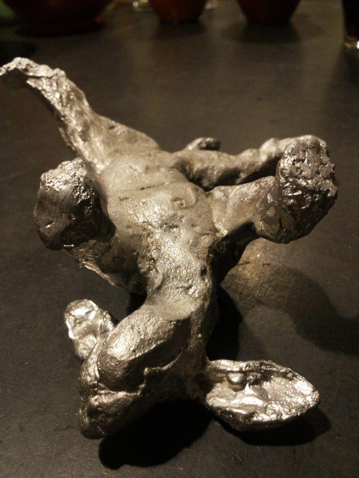 Dog cast in tin - Made by Marianne van den Berg