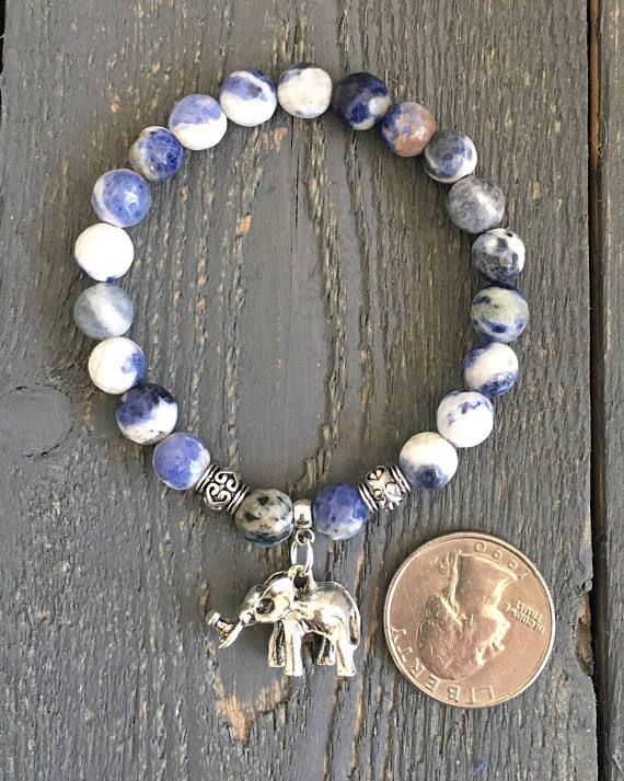 Elephant Bracelet with Sodalite Gemstones. The Elephant is known to be a general good luck symbol! ELEPHANT BRACELET -8mm Round Sodalite Genuine Gemstones. -Elephant Charm is 3-D Silver Tone made from zinc alloy metal which is lead & nickel free. -Made on Stretch Elastic Cord. -Second