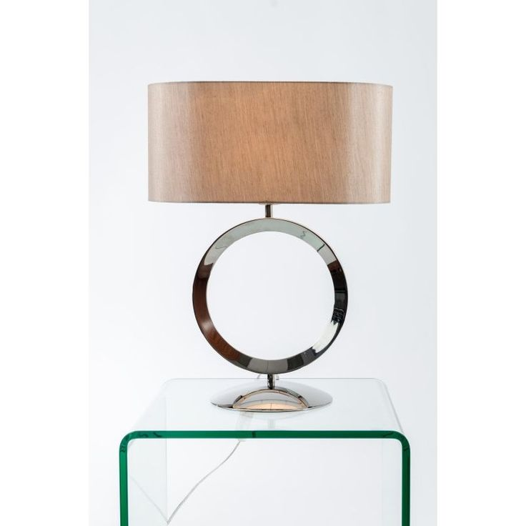 The stylish thornton polished chrome hoop table lamp has an unusual oval silky taupe shade