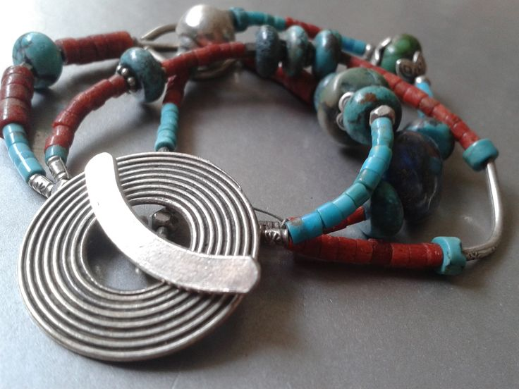 Beaded bracelet w. Big unique round silver lock, turquoise, coral & silver beads