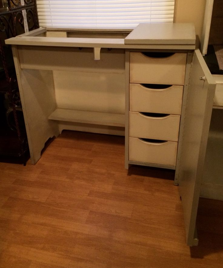 Chalk painted sewing machine cabinet turned into a bar open view