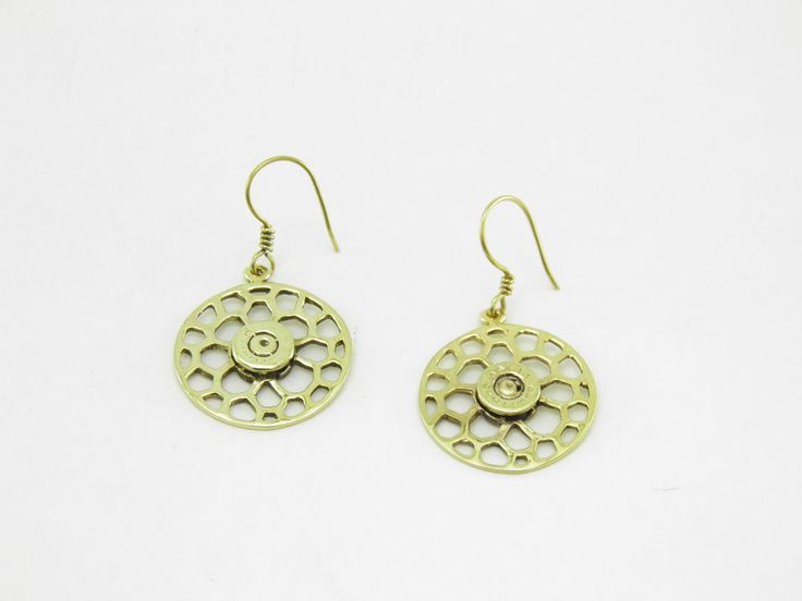 """Recycled brass Earrings Round Bees Nest and bullet rim; you won't be able to do without it! Recycled brass earrings molded from empty gun bullets. """"Transforming violence into beauty and peace!"""""""