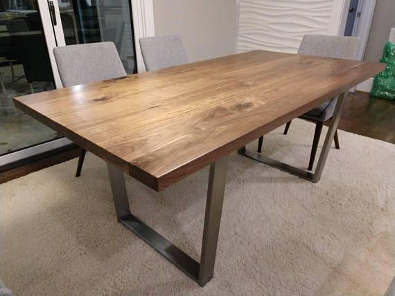 This Table Is Made From Solid Walnut And Features Robust Metal