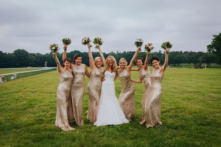 She got married! The ladies celebrate. Photo by Benjamin Stuart Photography #weddingphotography #bride #bridesmaids #goldwedding #groupphoto #girlsjustwanttohavefun