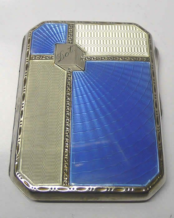 """Art Deco Silver and Enamel Case  A stunning 1930s sterling silver case with two colour enamel art deco decoration and engine turned silver. Interesting inscribed """"Dot"""" in a cube design cartouche. Original gilt interior. Birmingham 1933."""
