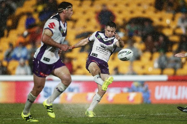 Cooper Cronk Photos Photos - Cooper Cronk of the Storm kicks the ball ahead during the round two NRL match between the New Zealand Warriors and the Melbourne Storm at Mt Smart Stadium on March 10, 2017 in Auckland, New Zealand. - NRL Rd 2 - Warriors v Storm