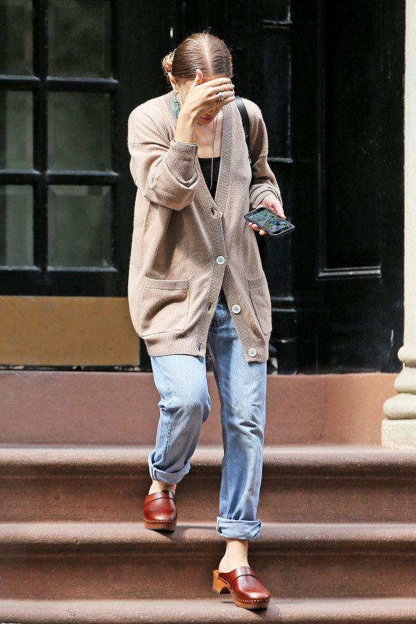 Ashley Olsen in an oversized cardigan and boyfriend jeans