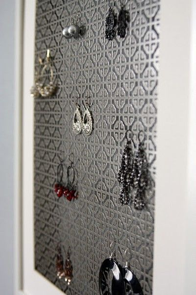 radiator grates (from Home Depot) framed out | A surprisingly stylish way to organize earrings